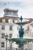Building and fountain in Baixa district, Lisbon, Portugal