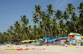 Tourists relaxing at beautiful tropical beach,Palolem,India