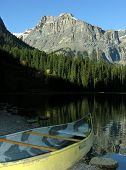 Canoe On A Shore Of Emerald Lake, Yoho National Park, Canada