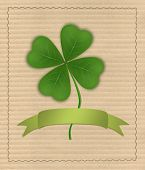 Clover With Four Leaves On Cardboard