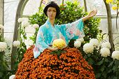 Asian Mannequin in a Flower Garden