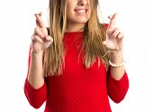 Young Girl Crossing His Fingers Over White Background