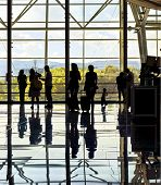 Silhouettes Of Unrecognizable Traveling People At The Airport