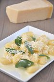 Potato gnocchi with burnt sage butter and Parmesan cheese.