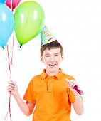 Happy smiling boy in orange t-shirt holding colorful balloons - isolated on a white.