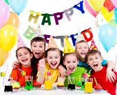 Group of laughing kids having fun at the birthday party - isolated on a white.