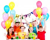 Group of children in colorful shirts at the birthday party with raised hands - isolated on a white.