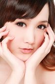 girl Skin care smile face close up and her touch health face