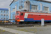 Passenger train goes on the territory of the locomotive depot