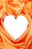 Paper heart in orange satin.