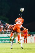 Sisaket Thailand-june 8: Ekkapan Jandakorn Of Sisaket Fc. (orange) In Action During Thai Premier Lea