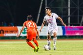 Sisaket Thailand-june 8: Teerasil Dangda Of Muangthong Utd. (white) In Action During Thai Premier Le