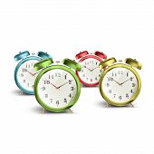 Set Of Colorful Vintage Table Clocks Over Isolated White Background