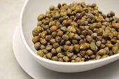 Marinated Capers On A White Plate