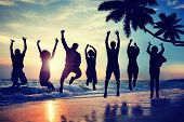 stock photo of leaping  - Young People Jumping with Excitement on a Beach - JPG