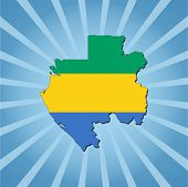 Gabon map flag on blue sunburst illustration