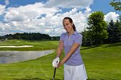 stock photo of ladies golf  - Attractive woman golfer on the fairway at the golf course - JPG