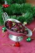 Traditional cranberry sauce with rosemary in a gravy boat