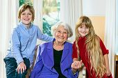 image of babysitting  - Smiling elderly grey - JPG