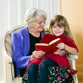 Grandma Reading To Her Grand Daughter