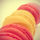 some appetizing macarons of different flavors with a retro filter effect
