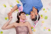 happy easter couple lying smiling