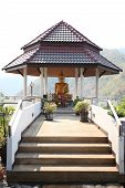 picture of dam  - Buddha in a pavilion on the hill at  Water storage dam - JPG