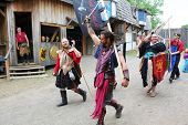MUSKOGEE, OK - MAY 24: Performers walk in the parade at the Oklahoma 19th annual Renaissance Festival on May 24, 2014 at the Castle of Muskogee in Muskogee, OK