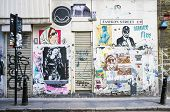 LONDON, UK - APRIL 18, 2014: Graffiti, posters and stickers on Fashion Street, Spitalfields / Whitec