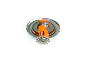 stock photo of retarded  - Close up image of fire sprinkler on white - JPG