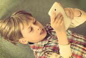 boy taking selfie with smart phone
