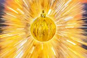 Golden Christmas Ball On Abstract Background