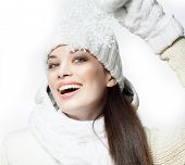 closeup portrait of attractive  caucasian smiling woman brunette isolated on white studio shot  toothy smile face hair head and shoulders looking at camera winter christmas warm clothing