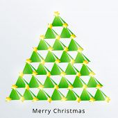 Stylish X-mas tree decorated with shiny stars for Merry Christmas celebration on blue background.