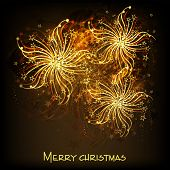 Poster or banner for Merry Christmas with shiny golden explosion of firecrackers on brown background.