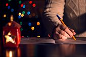stock photo of letters to santa claus  - The child writes a letter to Santa Claus