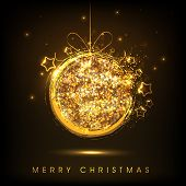 Merry Christmas celebration with shiny golden X-mas ball on brown background.