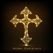 Golden floral decorated Religious Christianity Cross on brown background for Merry Christmas celebrations.