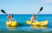 Man and Woman Kayaking in Tropical Ocean on Vacation
