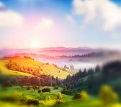 Beautiful sunny day is in mountain landscape. Carpathian, Ukraine, Europe. Beauty world. Retro style filter. Instagram toning effect. Tilt Shift blur effect.