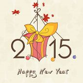 Happy New Year 2015 greeting card design with hanging stylish text and gift box on beige background.