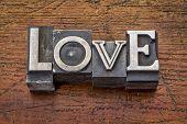 love word in vintage metal type printing blocks over grunge wood