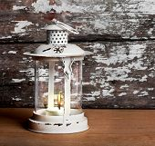 Old Christmas Lantern On Background Of  Old Brick Wall And Floor