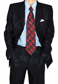 Man In A Black Suit Holds Hands In Pockets
