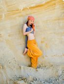 Woman wearing in asian style in desert landscape