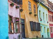 Street with colourful buildings in Romania.