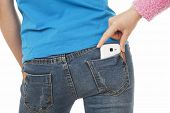 Sexy Woman With A Cell Phone In Her Back Pocket