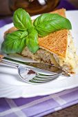 Freshly baked traditional Russian homemade pie with potatoes and meat. Shallow dof.