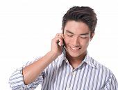 young business asian man using cell phone