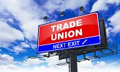 Trade Union Inscription on Red Billboard.